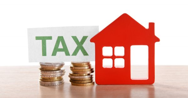 What are the tax benefits associated with owning a rental home?